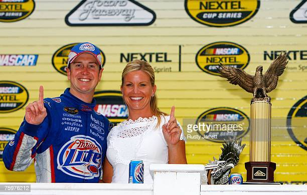 Kurt Busch driver of the Miller Lite Dodge celebrates in victory lane with his wife Eva after winning the NASCAR Nextel Cup Series Pennsylvania 500...