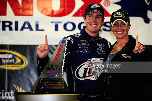 Kurt Busch driver of the Miller Lite Dodge celebrates in victory lane with his wife Eva after winning the NASCAR Sprint Cup Series LENOX Industrial...