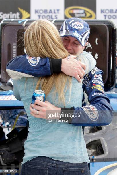Kurt Busch driver of the Miller Lite Dodge celebrates in victory lane with his wife Eva after winning the NASCAR Sprint Cup Series Kobalt Tools 500...