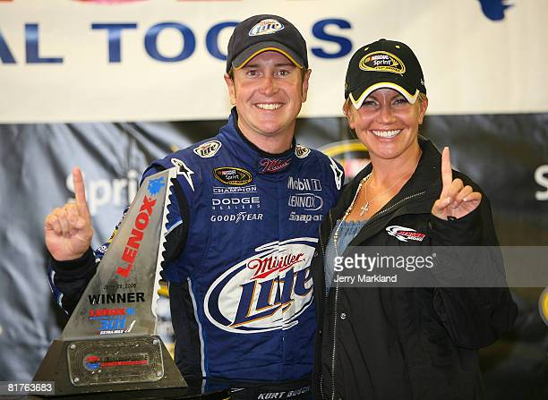 Kurt Busch driver of the Miller Lite Dodge celebrates in Victory Lnae with wife Eva after winning the NASCAR Sprint Cup Series LENOX Industrial Tools...