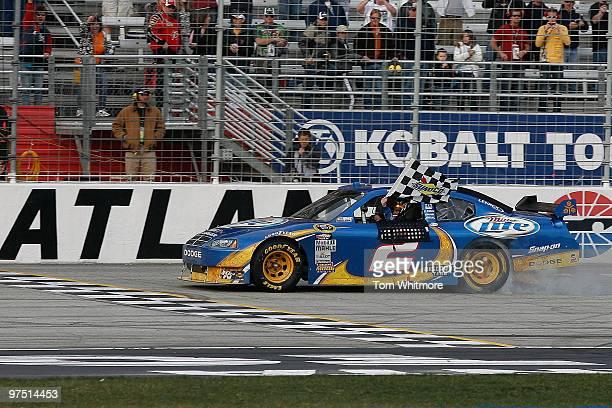Kurt Busch, driver of the Miller Lite Dodge, celebrates on track after winning the NASCAR Sprint Cup Series Kobalt Tools 500 at Atlanta Motor...