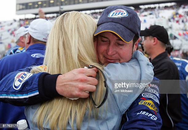 Kurt Busch driver of the Miller Lite Dodge celebrates with his wife Eva after winning the NASCAR Sprint Cup Series LENOX Industrial Tools 301 at New...
