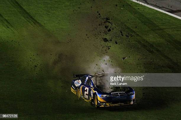 Kurt Busch driver of the Miller Lite Dodge drives over grass after losing control on the front straight during the Budweiser Shootout at Daytona...