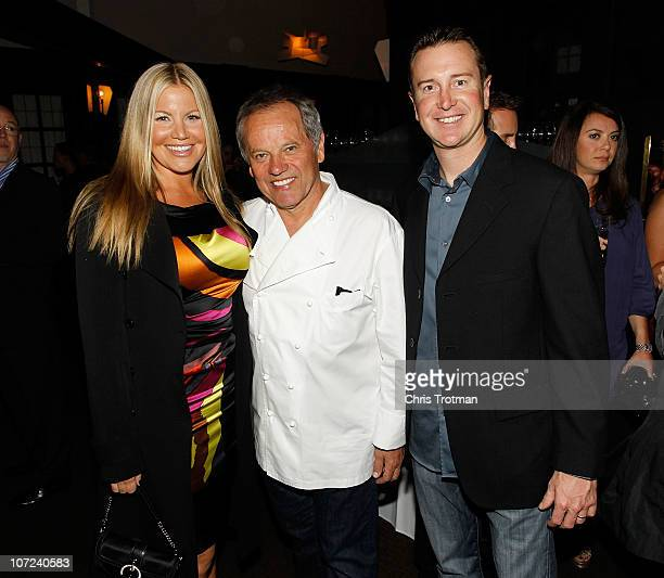 Kurt Busch driver of the Miller Lite Dodge his wife Eva and Celebrity chef Wolfgang Puck attend NASCAR Evening Series during day 2 of the NASCAR...