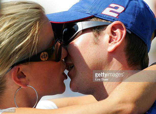 Kurt Busch driver of the Miller Lite Dodge kiss his wife Eva Bryan prior to qualifying for the NASCAR Nextel Cup Series Allstate 400 at the Brickyard...