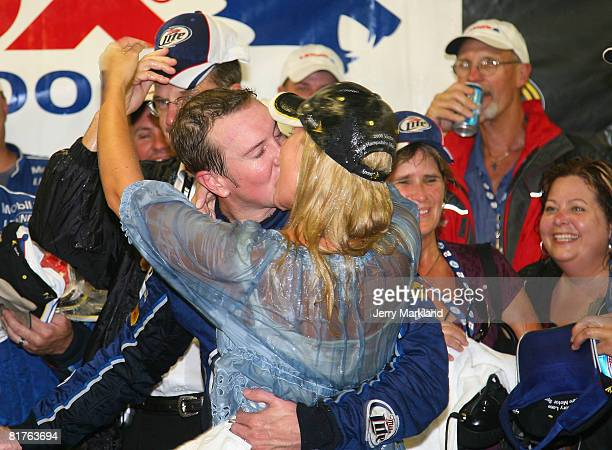 Kurt Busch driver of the Miller Lite Dodge kisses his wife Eva in Victory Lane after winning the NASCAR Sprint Cup Series LENOX Industrial Tools 301...