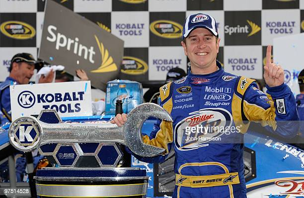 Kurt Busch, driver of the Miller Lite Dodge, poses in Victory Lane after winning the NASCAR Sprint Cup Series Kobalt Tools 500 at Atlanta Motor...