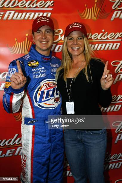 Kurt Busch driver of the Miller Lite Dodge poses with fiancee Eva Bryan after winning the pole for the NASCAR Nextel Cup Series Auto Club 500 on...
