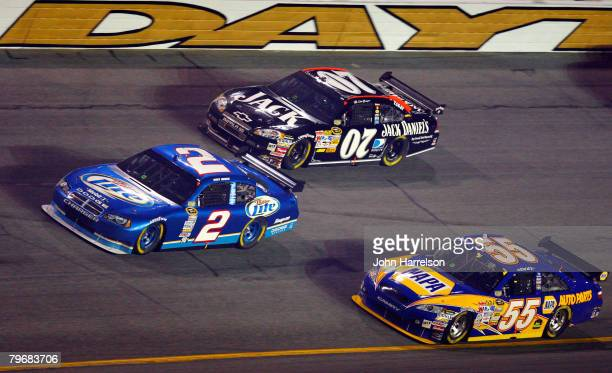 Kurt Busch driver of the Miller Lite Dodge races in front of Clint Bowyer driver of the Jack Daniel's Chevrolet and Michael Waltrip driver of the...