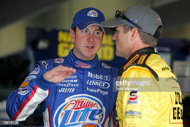 Kurt Busch driver of the Miller Lite Dodge speaks with Bobby Labonte driver of the Cheerios/Betty Crocker Dodge prior to practice for the NASCAR...