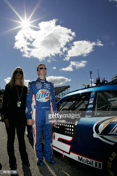 Kurt Busch driver of the Miller Lite Dodge stands on pit road with his wife Eva prior to the NASCAR Nextel Cup Series Sylvania 300 at New Hampshire...