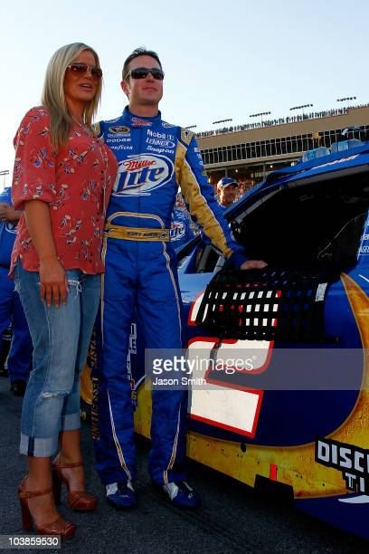 Kurt Busch driver of the Miller Lite Dodge stands with his wife Eva on the grid prior to the start of the NASCAR Sprint Cup Series Emory Healthcare...