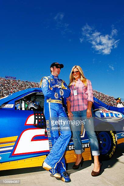 Kurt Busch driver of the Miller Lite Dodge stands with his wife Eva on pit road prior to the NASCAR Sprint Cup Series TUMS Fast Relief 500 at...
