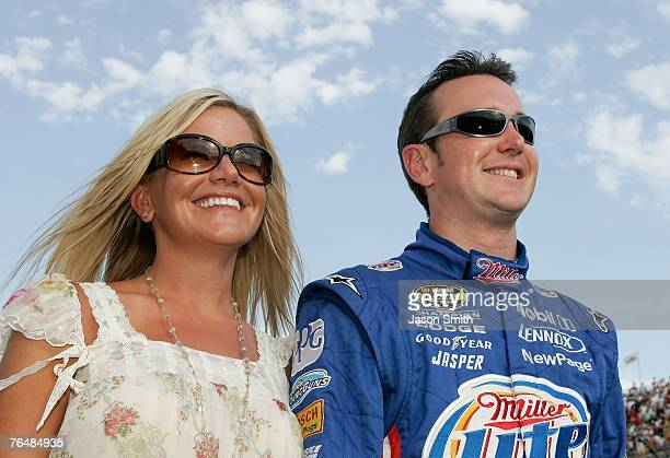 Kurt Busch driver of the Miller Lite Dodge stands with his wife Eva on the grid prior to the start of the NASCAR Nextel Cup Series Sharp Aquos 500 at...