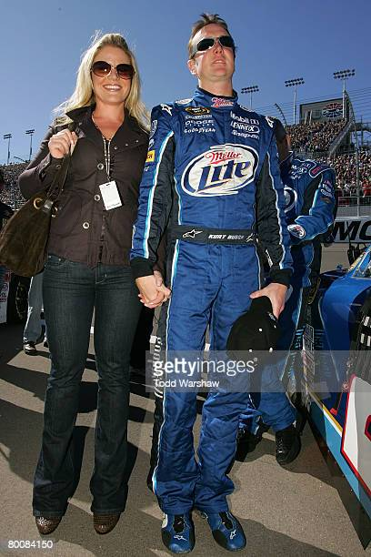 Kurt Busch driver of the Miller Lite Dodge stands with his wife Eva on the grid prior to the start of the NASCAR Sprint Cup Series UAWDodge 400 at...