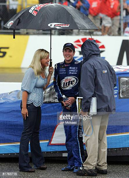 Kurt Busch driver of the Miller Lite Dodge stands with his wife Eva prior to being declared the winner of the NASCAR Sprint Cup Series LENOX...