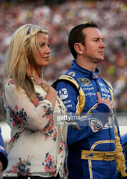 Kurt Busch driver of the Miller Lite Dodge stands with his wife Eva on the grid prior to the start of the the NASCAR Sprint Cup Series Crown Royal...