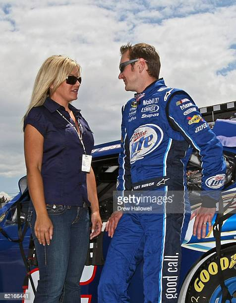Kurt Busch driver of the Miller Lite Dodge talks with his wife Eva on pit road prior to the NASCAR Sprint Cup Series Sunoco Red Cross Pennsylvania...