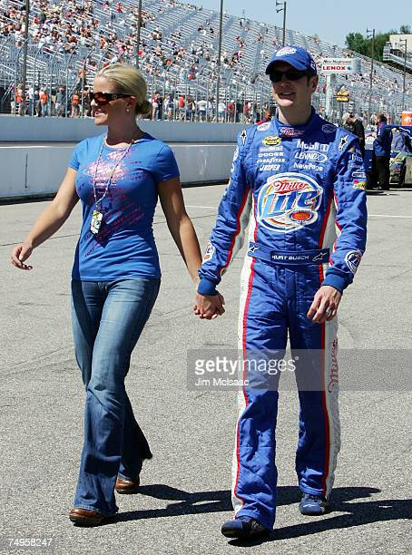 Kurt Busch driver of the Miller Lite Dodge walks with his wife Eva during qualifying for the NASCAR Nextel Cup Series Lenox Industrial Tools 300 at...