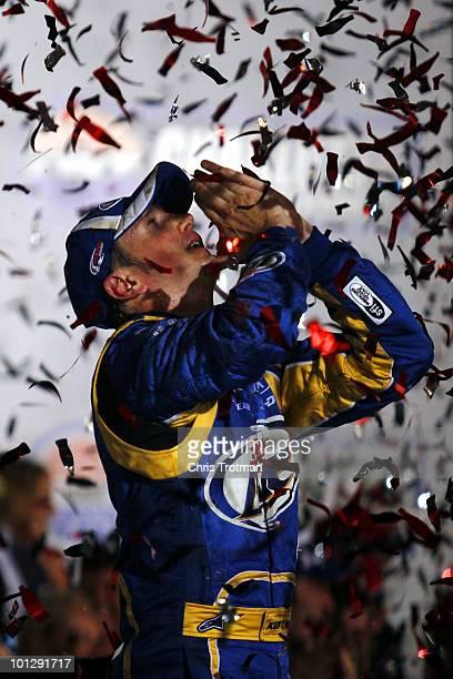Kurt Busch, driver of the Miller Lite/Vortex Dodge, celebrates in Victory Lane after winning the NASCAR Sprint Cup Series Coca-Cola 600 at Charlotte...