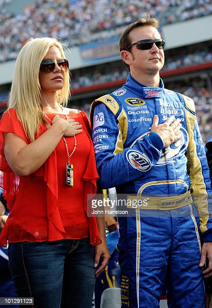 Kurt Busch driver of the Miller Lite/Vortex Dodge stands on the grid with his wife Eva prior to the start of the NASCAR Sprint Cup Series CocaCola...