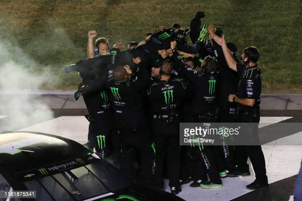 Kurt Busch driver of the Monster Energy Chevrolet celebrates with his crew members after winning the Monster Energy NASCAR Cup Series Quaker State...