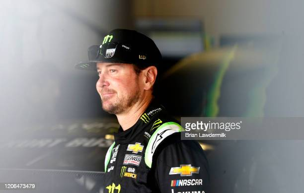Kurt Busch driver of the Monster Energy Chevrolet stands in the garage area during practice for the NASCAR Cup Series 62nd Annual Daytona 500 at...