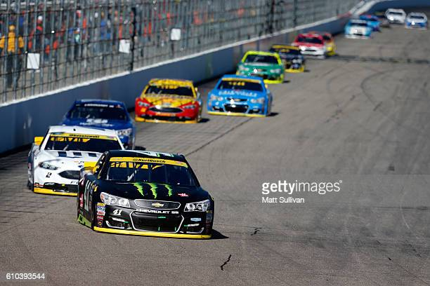 Kurt Busch driver of the Monster Energy/Haas Automation Chevrolet leads a pack of cars during the NASCAR Sprint Cup Series Bad Boy Off Road 300 at...