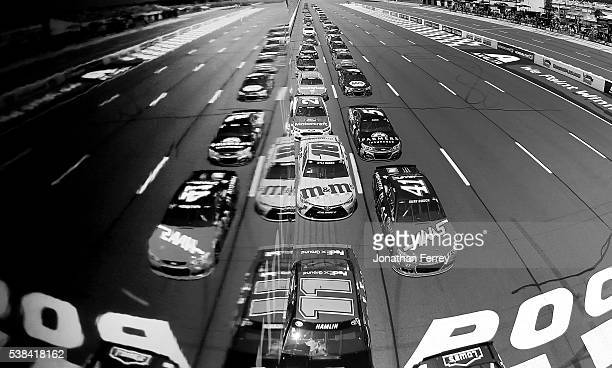 Kurt Busch driver of the Monster Energy/Haas Automation Chevrolet and Denny Hamlin driver of the FedEx Ground Toyota lead a pack of cars during the...