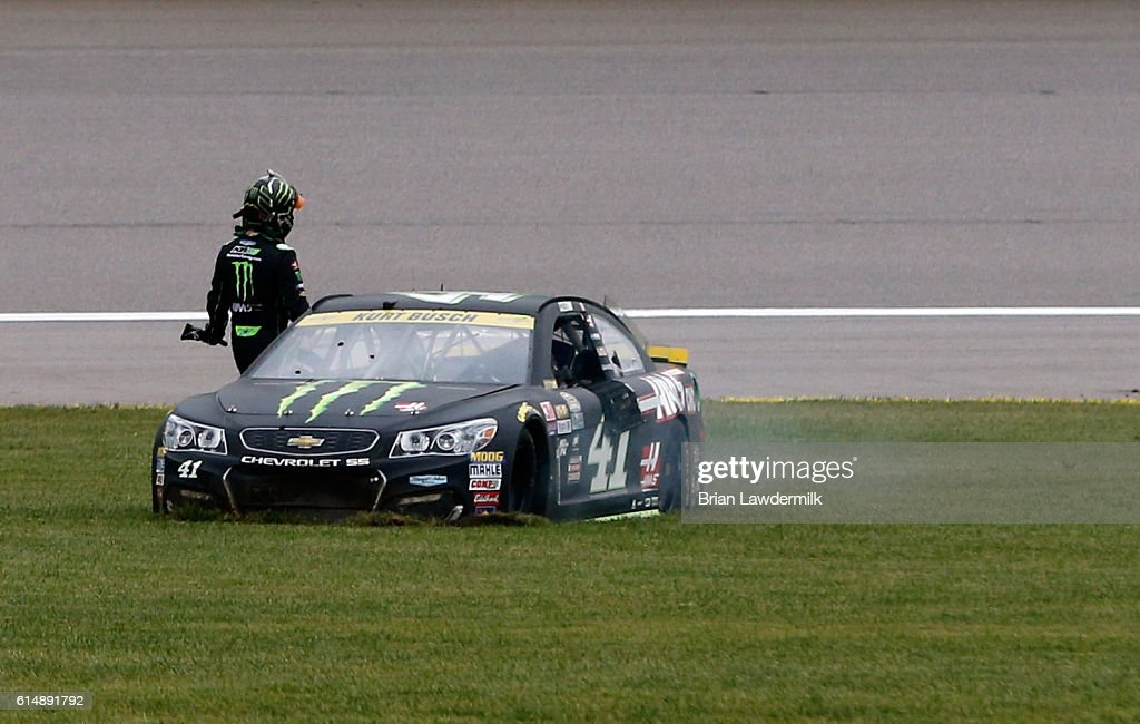 Kurt Busch, driver of the #41 Monster Energy/Haas Automation Chevrolet, stands by his car after an on-track incident during practice for the NASCAR Sprint Cup Series Hollywood Casino 400 at Kansas Speedway on October 15, 2016 in Kansas City, Kansas.
