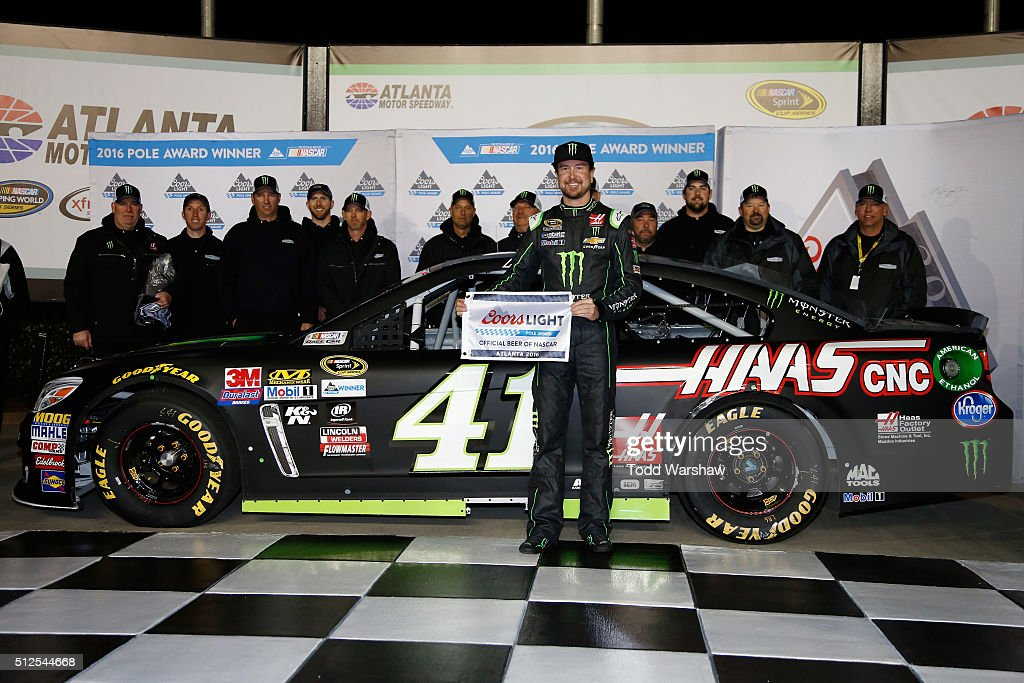Kurt Busch, driver of the #41 Monster Energy/Haas Automation Chevrolet, poses with the Coors Light Pole Award after qualifying for pole position for the NASCAR Sprint Cup Series Folds of Honor QuikTrip 500 at Atlanta Motor Speedway on February 26, 2016 in Hampton, Georgia.