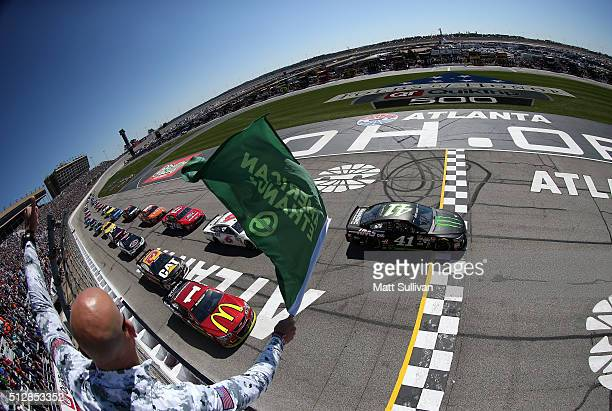 Kurt Busch driver of the Monster Energy/Haas Automation Chevrolet leads the field past the green flag to start the NASCAR Sprint Cup Series Folds of...