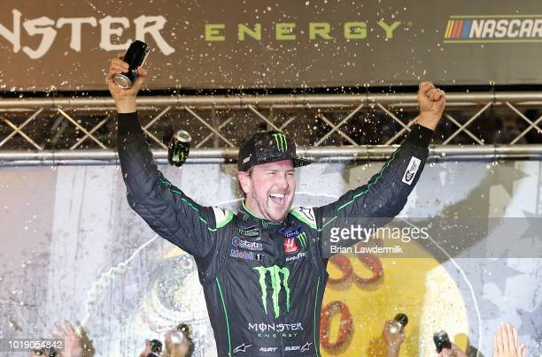 Kurt Busch driver of the Monster Energy/Haas Automation Ford celebrates in Victory Lane after winning the Monster Energy NASCAR Cup Series Bass Pro...