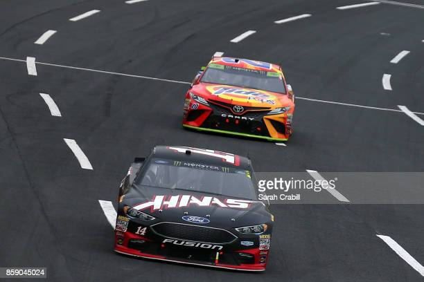 Kurt Busch driver of the Monster Energy/Haas Automation Ford leads Matt Kenseth driver of the Tide Pods Toyota during the Monster Energy NASCAR Cup...
