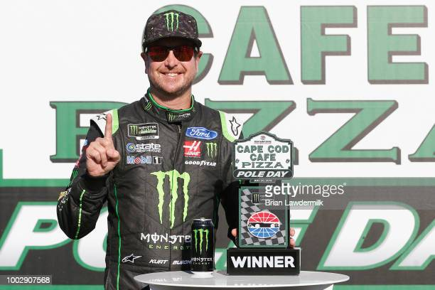 Kurt Busch driver of the Monster Energy/Haas Automation Ford poses with the Cape Cod Cafe Pizza Pole Award after posting the fastest lap during...