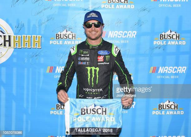 Kurt Busch driver of the Monster Energy/Haas Automation Ford poses with the pole award after qualifying for the Monster Energy NASCAR Cup Series...