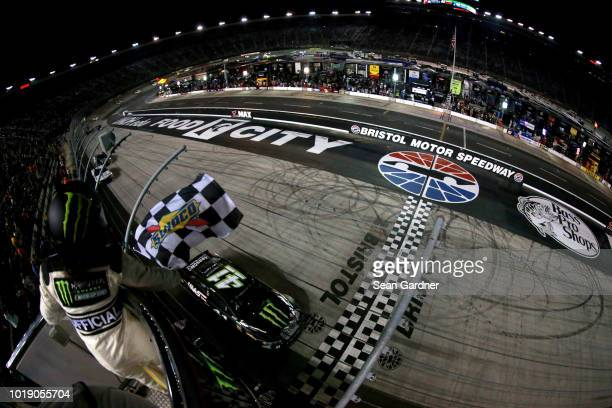 Kurt Busch driver of the Monster Energy/Haas Automation Ford takes the checkered flag to win the Monster Energy NASCAR Cup Series Bass Pro Shops NRA...