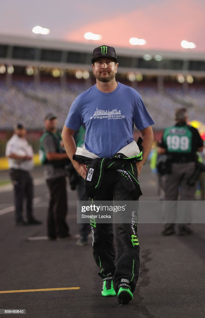 Kurt Busch, driver of the #41 Monster Energy/Haas Automation Ford, walks on the grid during qualifying for the Monster Energy NASCAR Cup Series Bank of America 500 at Charlotte Motor Speedway on October 6, 2017 in Charlotte, North Carolina.