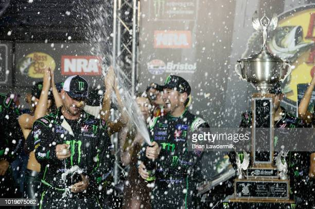 Kurt Busch driver of the Monster Energy/Haas Automation Ford celebrates with crew members in Victory Lane after winning the Monster Energy NASCAR Cup...