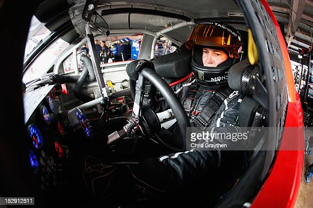 Kurt Busch driver of the Phoenix Construction Chevrolet sits in his car in the garage area during practice for the NASCAR Sprint Cup Series AAA 400...