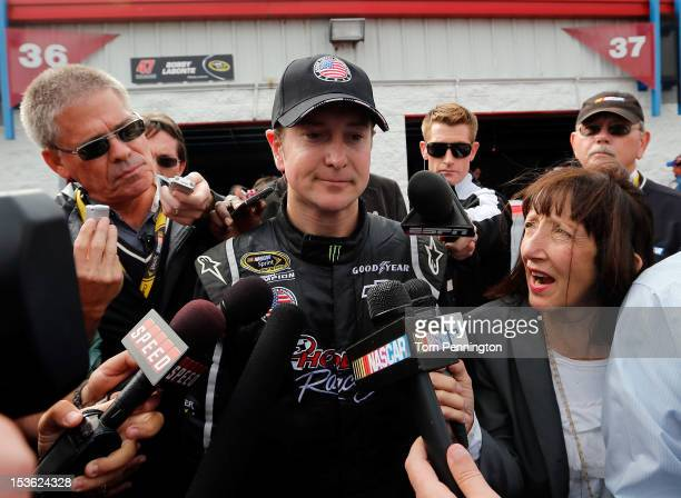 Kurt Busch driver of the Phoenix Construction Chevrolet talks to the media after an incident during the NASCAR Sprint Cup Series Good Sam Roadside...