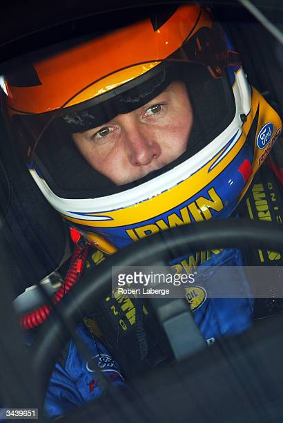 Kurt Busch driver of the Roush Racing IRWIN Industrial Tools Ford sits in his car in the garage before the start of practice for the NASCAR Nextel...