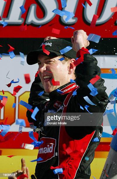 Kurt Busch Driver of the Roush Racing Rubbermade Ford Taurus celebrates winning the NASCAR Winston Cup Food City 500 at Bristol Motor Speedway on...