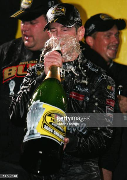 Kurt Busch driver of the Roush Racing Sharpie Ford celebrates with champagne after winning the NASCAR Nextel Cup Series Championship at the Ford 400...