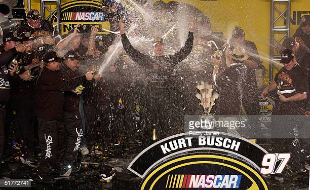 Kurt Busch driver of the Sharpie Ford celebrates winning the NASCAR Nextel Cup Series Championship at the Ford 400 on November 21 2004 at the...