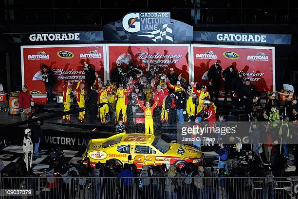 Kurt Busch driver of the Shell/Pennzoil Dodge celebrates in Victory Lane after winning the Budweiser Shootout at Daytona International Speedway on...