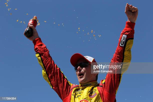Kurt Busch driver of the Shell/Pennzoil Dodge celebrates in victory lane after winning the NASCAR Sprint Cup Series Toyota/Save Mart 350 at Infineon...