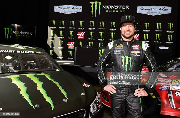 Kurt Busch driver of the StewartHaas Racing Chevrolet poses for a photo opportunity after a press conference announcing Monster Energy as a cosponsor...