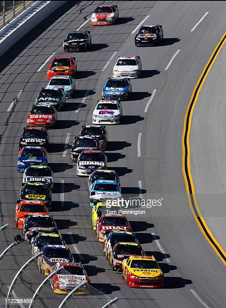 Kurt Busch drivner of the Shell/PennzoilAAA Dodge and Dave Blaney driver of the Golden Corral Chevrolet lead the field during the NASCAR Sprint Cup...