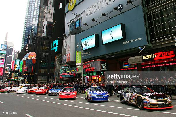 Kurt Busch in the car leads the top ten 2004 NASCAR NEXTEL Cup Series drivers as they begin a parade of show cars through Times Square as part of the...